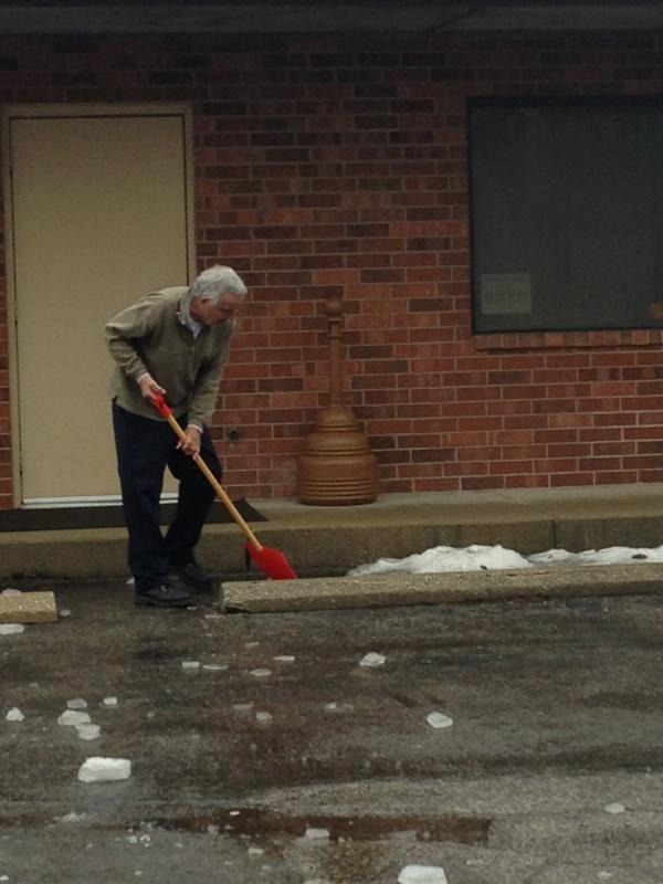 Dr. Klopfer shovels