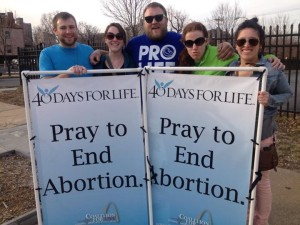 Joshua Schmidt, Maura Weis, Brad Baumgarten, Katy Guill, and Faith Mary promote life.