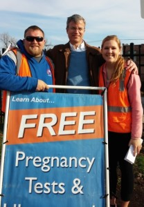Brad, Patrick Burns, and Melissa DeRocher offering free pregnancy tests