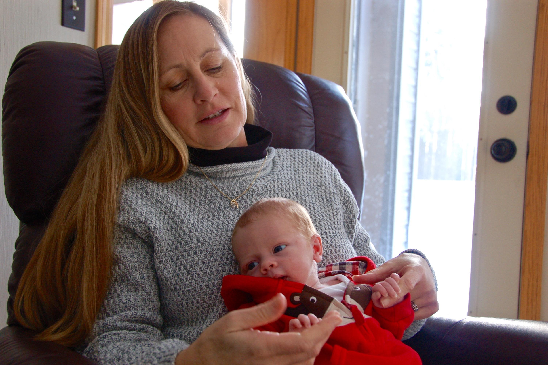 Bette Grande holds her newborn grandson