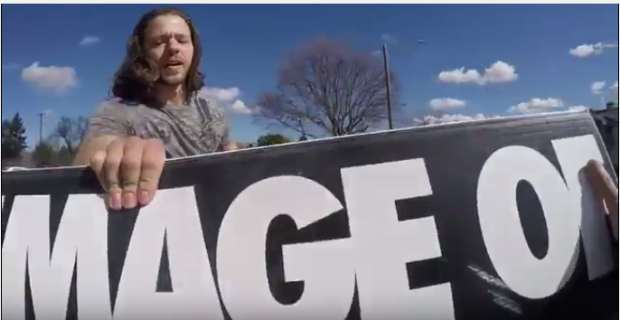 Post abortive man grabs avolitionist sign abortion prolife