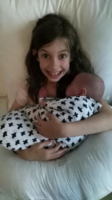 Benson's big sister is overcome with joy that he is finally home after being born premature.