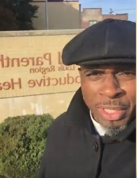 Bishop Vincent Matthews prays outside Planned Parenthood
