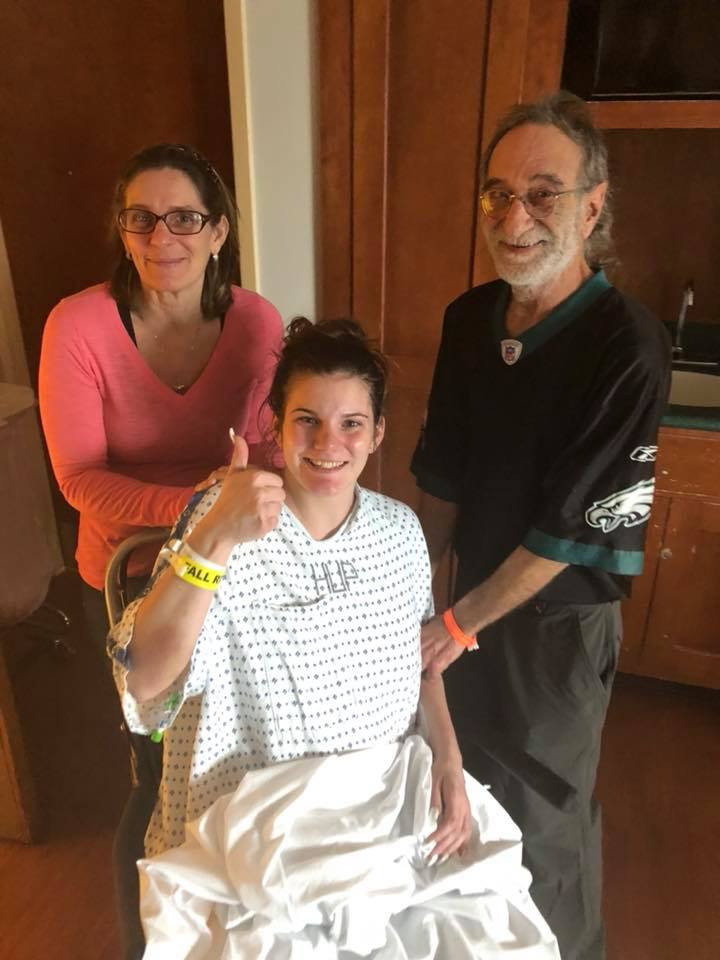 Dana Scatton with her parents shortly before her emergency C-section after she was diagnosed with a brain tumor.