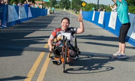 Sen. Duckworth, who supports unlimited abortions for women, participates in a race using an adapted bike.