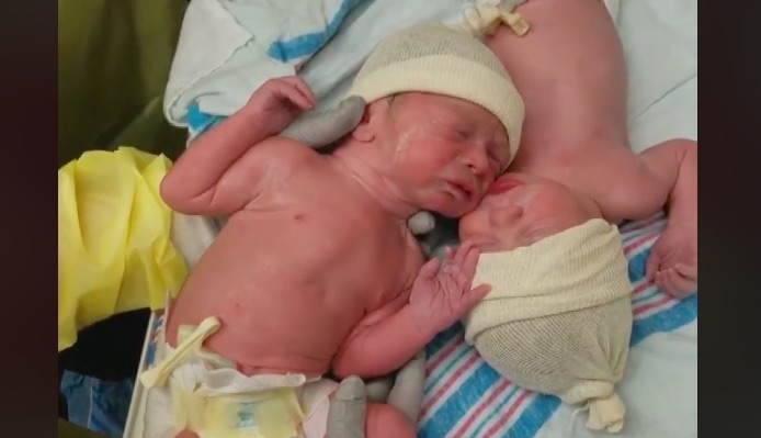 Twins comfort, Caleb and Weston
