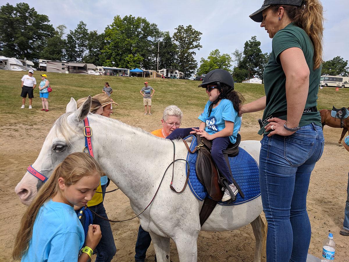 Faith who has Trisomy 18, loves riding horses