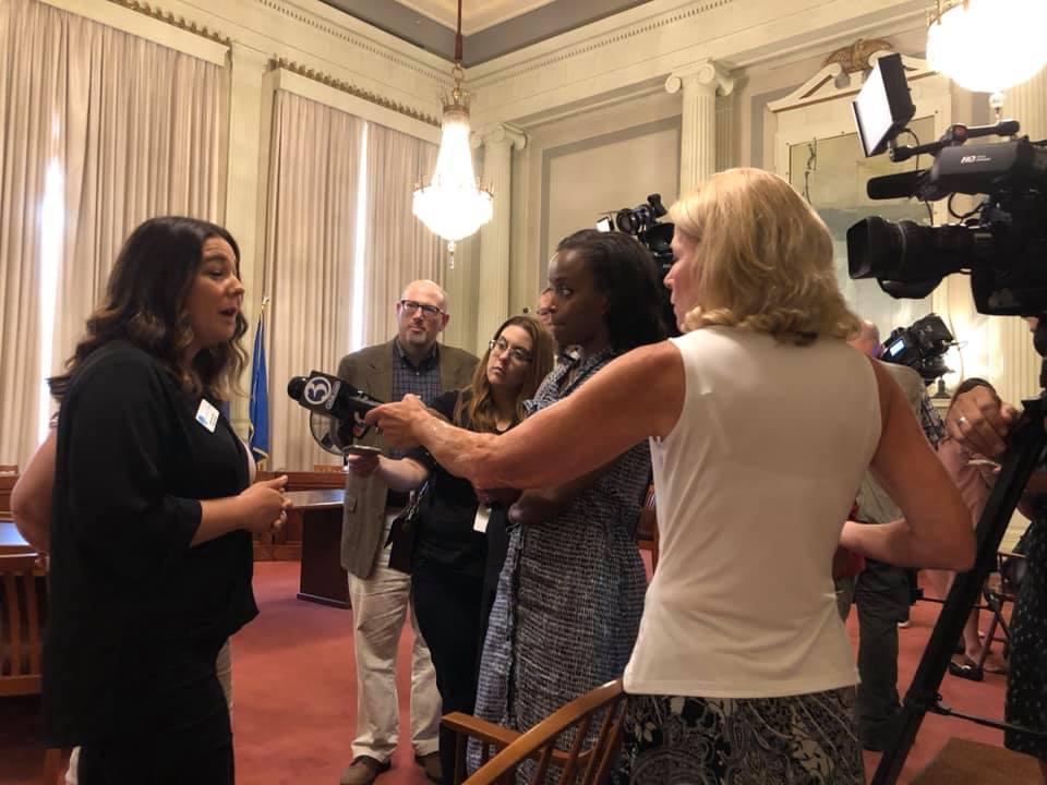 Molly Hurtado talks to reporters in Hartford.