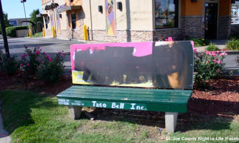 vandalized bench