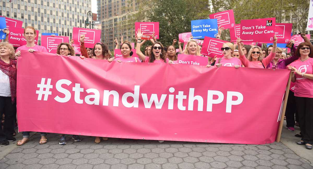 Activists hold Planned Parenthood banner in Foley Square.