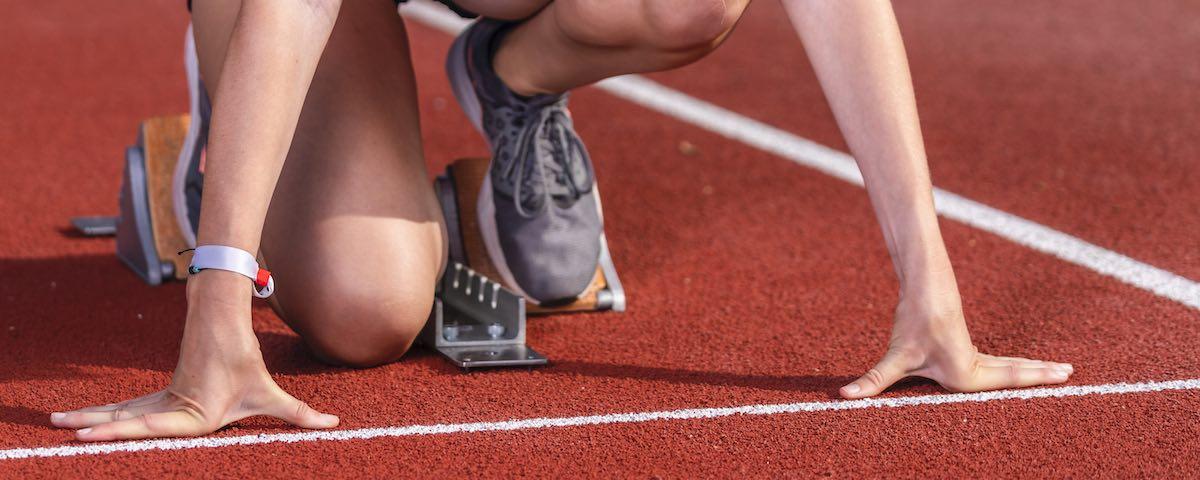 Female runner in starting position,