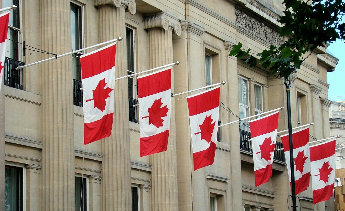 Canadian Flags Hanging By Building