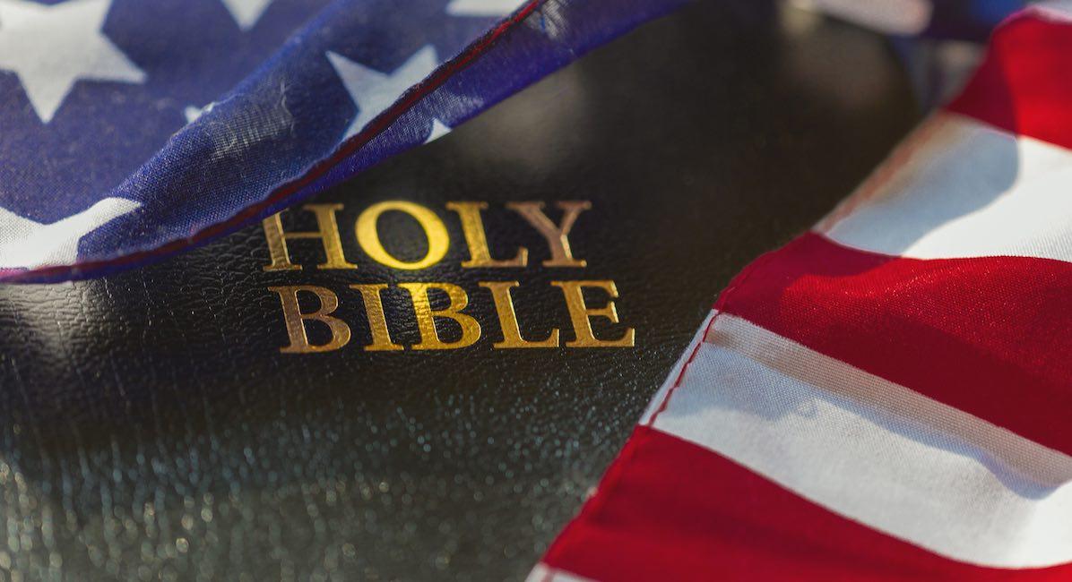 American flag draped over bible