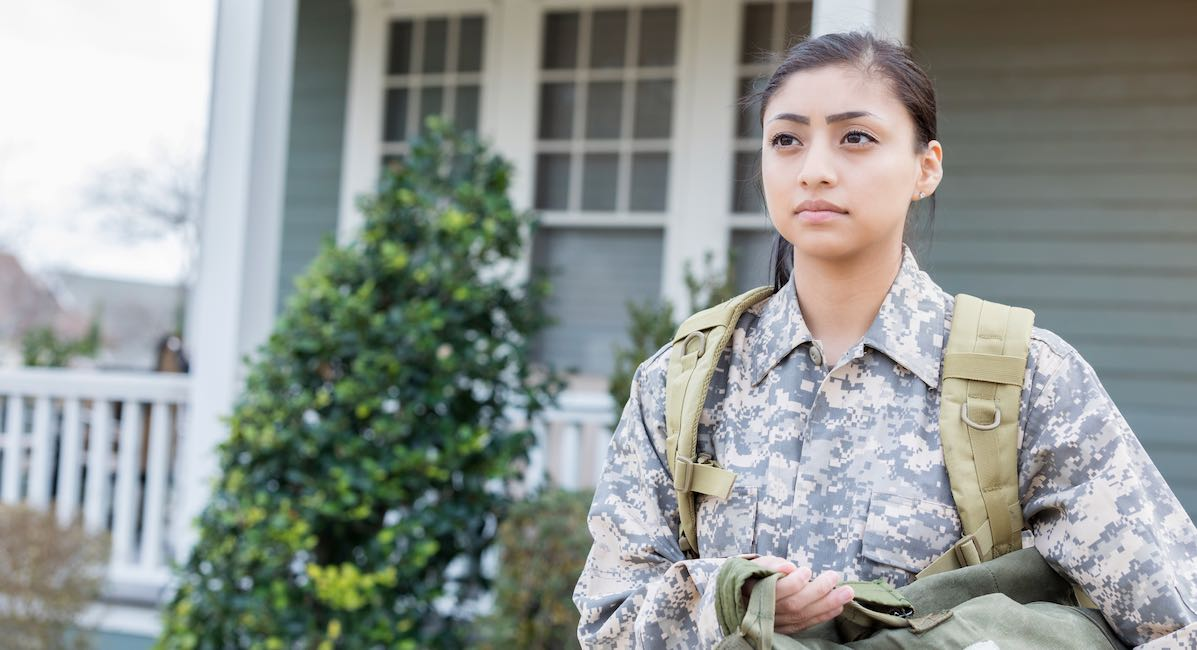 Serious female soldier leaving home