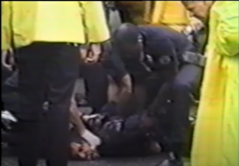 Police with knee in back of peaceful anti-abortion demonstrator Image Credit The Brutal Truth