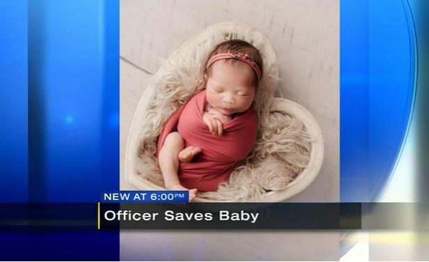 screenshot, officer saves baby