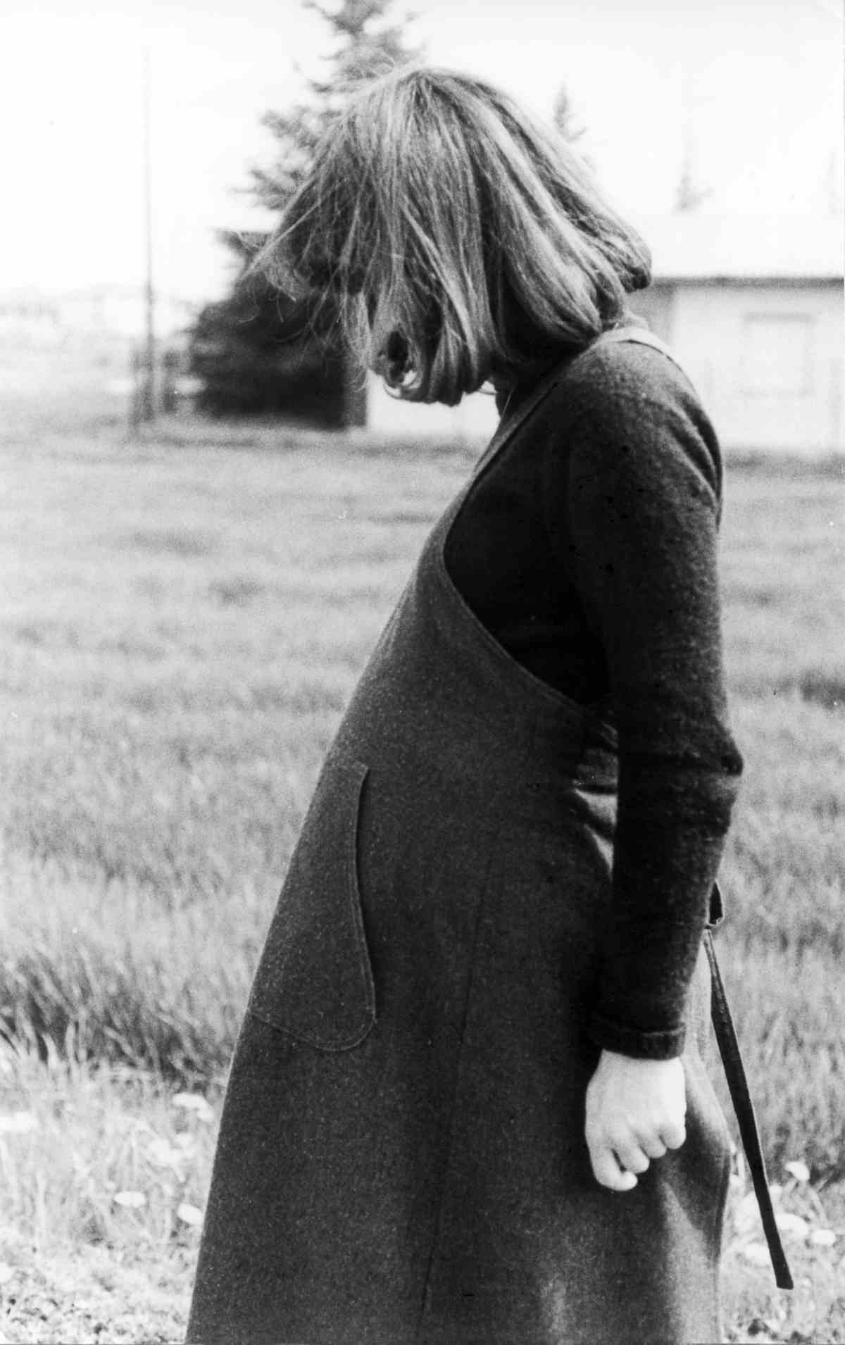 Pregnant woman in her thirties looking down